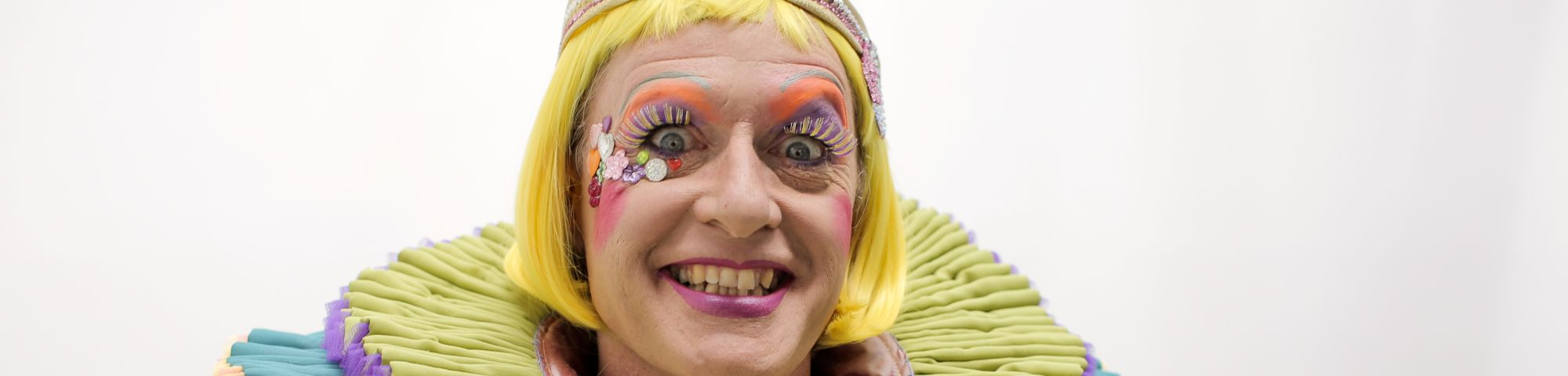 Head shot of Grayson Perry in his 2019 robes