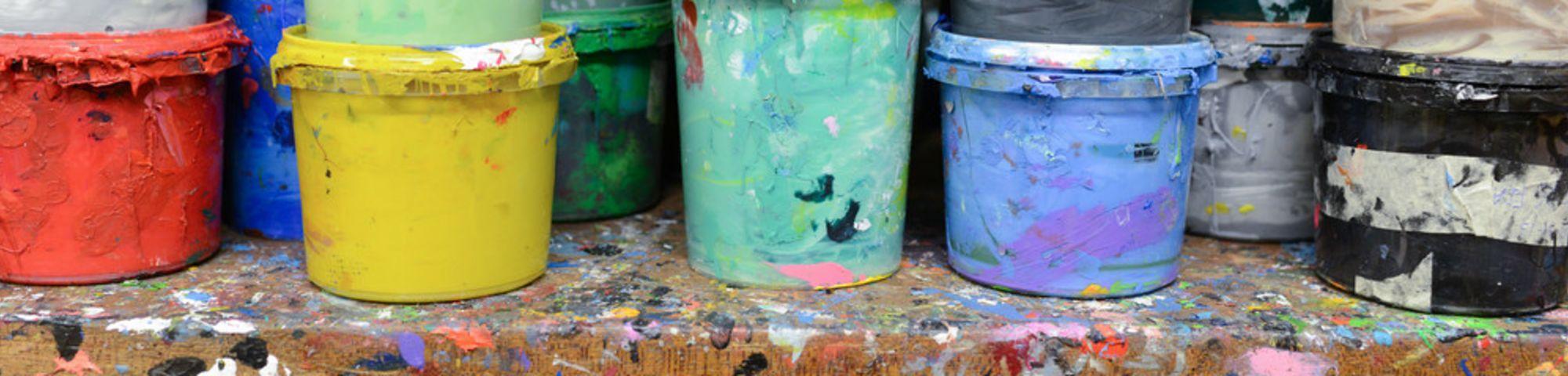 Paint pots on a shelf