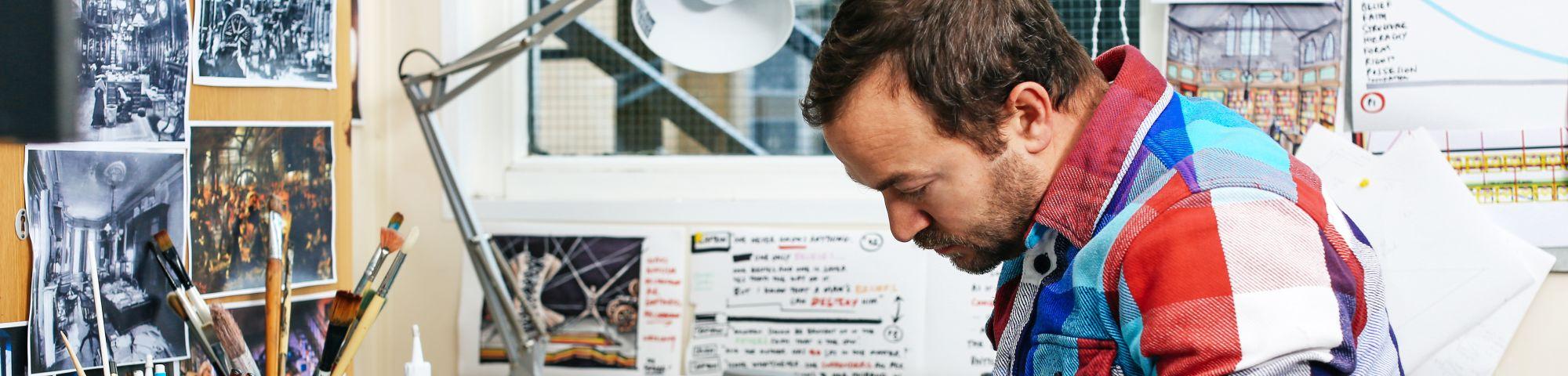 Yoav Segal working in his studio