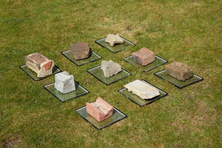 bricks on glass plates on top of grass