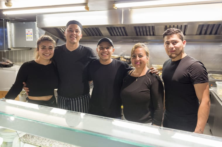Staff at Costa Azul behind the counter at their restaurant.