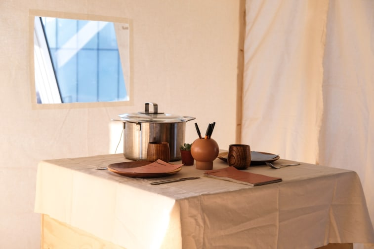 A table with plates and a cooking pot