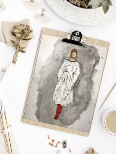 Illustration of a model wearing a baggy white dress with red boots on. The illustration is fixed on a clipboard.