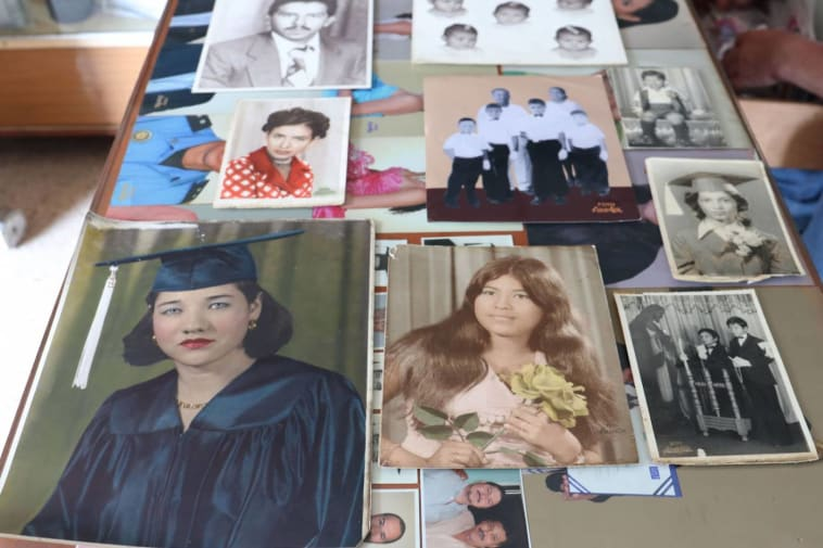 A selection of portrait photos on a table shot from above