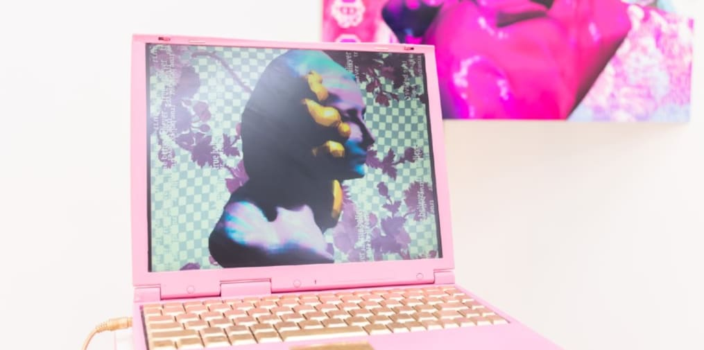 Student work of a pink computer with a gold keyboard.