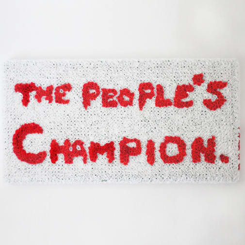 Flower wreath with text reading 'The People's Champion'.