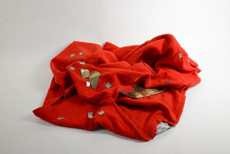Red Blanket (2013) Blanket, tin, nylon, work by Bridget Harvey