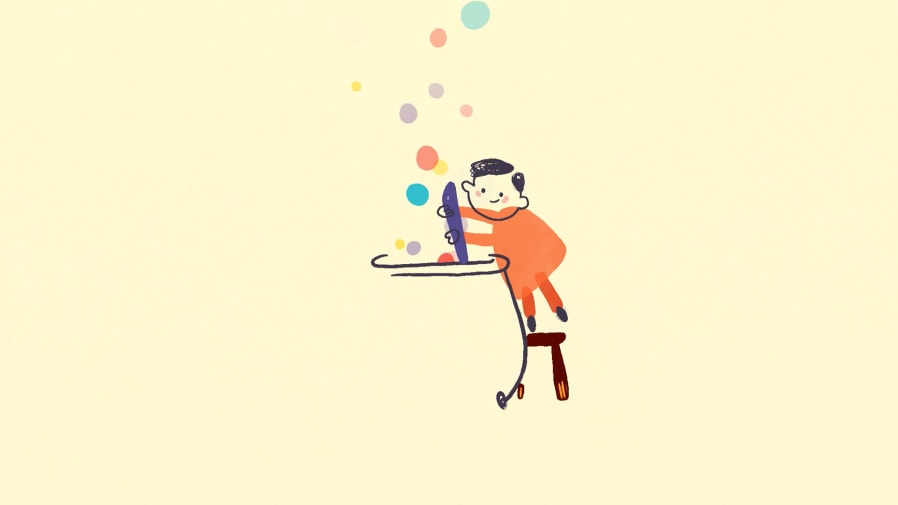 Small child drawing with bubbles of colour