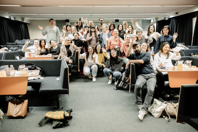 student group photo cheering in lecture theatre