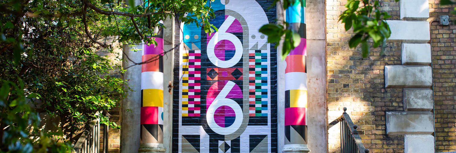 Colourful graphics painted on wall by Chelsea BA Graphic Design Communication student as part of Clerkenwell design week.