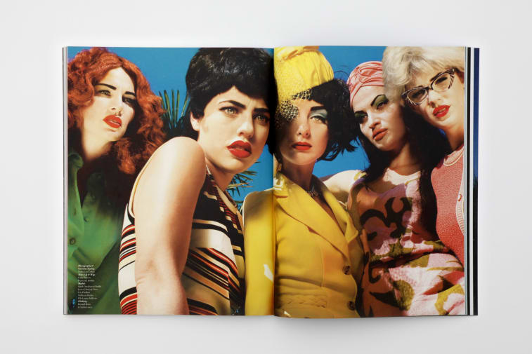 Double spread of Pigeons and Peacocks magazine featuring female models in striking colour outfits.