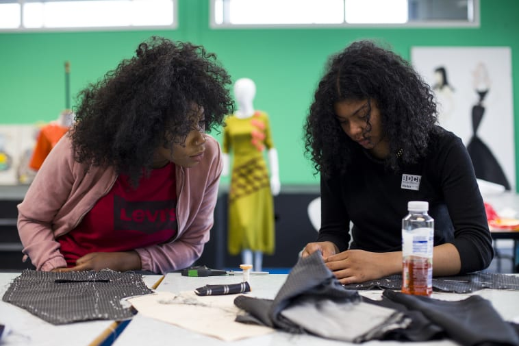 Students from Barking and Dagenham college taking part in the tailoring workshop