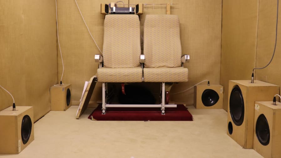 Room with chairs connected to speakers