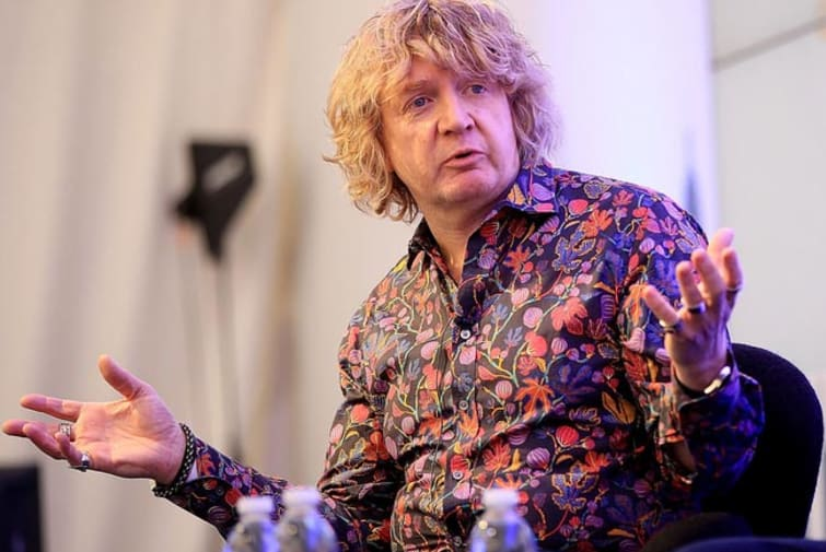 Profile image of Gary Knight mid talk on stage in floral shirt