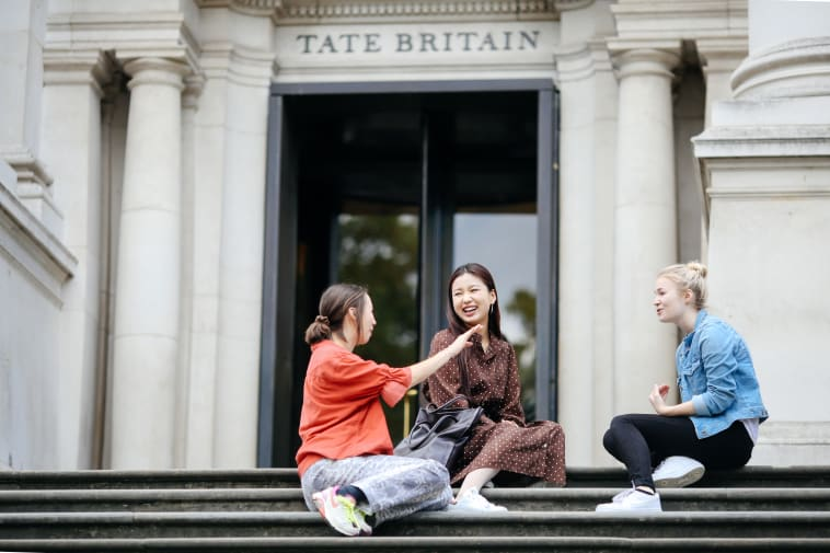students sitting outside TATE Britain