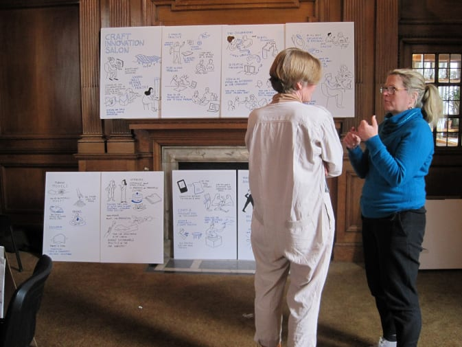 Two women in discussion in front of visual note taking