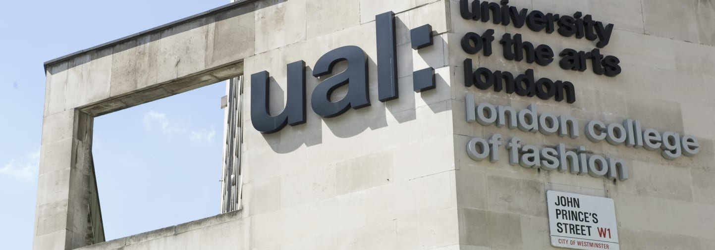 Side of building with big letters logo of UAL and London College of Fashion