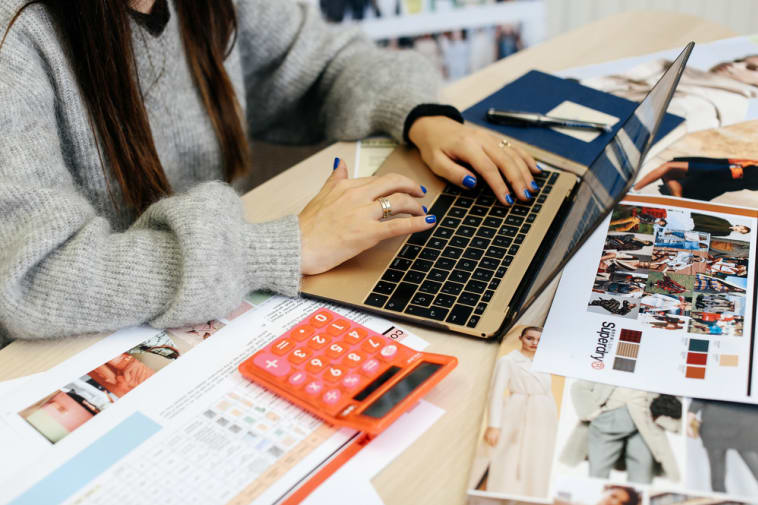 laptop with workbook and calculator