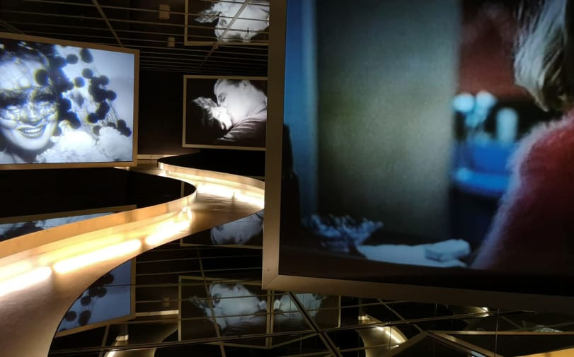 Image depicts film stills projected onto exhibition screens.