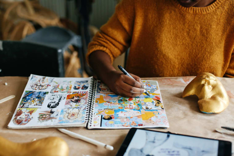 A student sketching in the studio