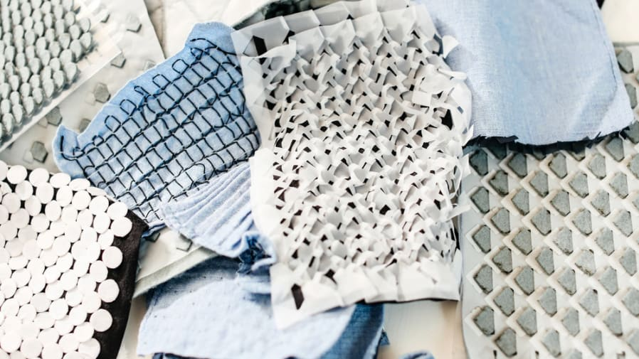 Selection of light coloured, textured fabrics