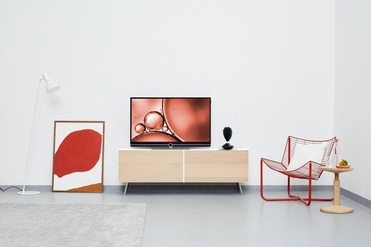 Black hovering crystal-shaped object set in living room