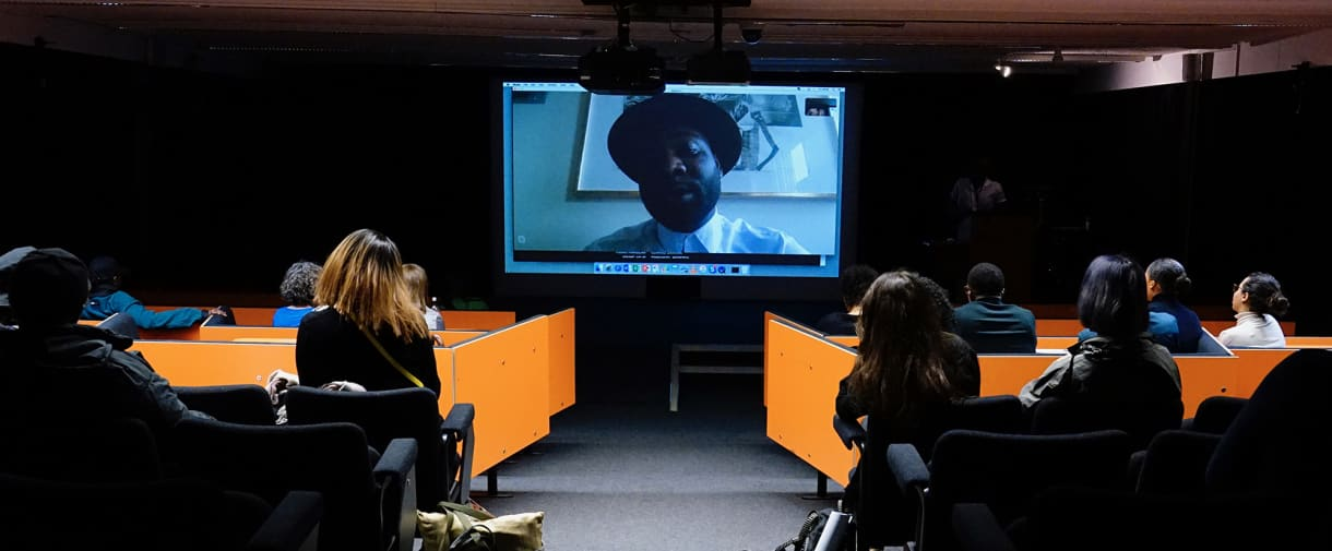 A shot of a skype conversation in a lecture theatre