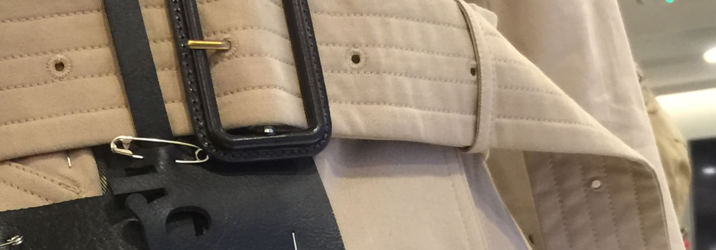 Close up of Burberry trench coat buckle