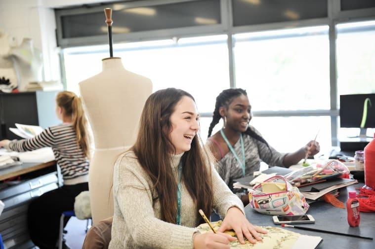Girls in art studio laughing