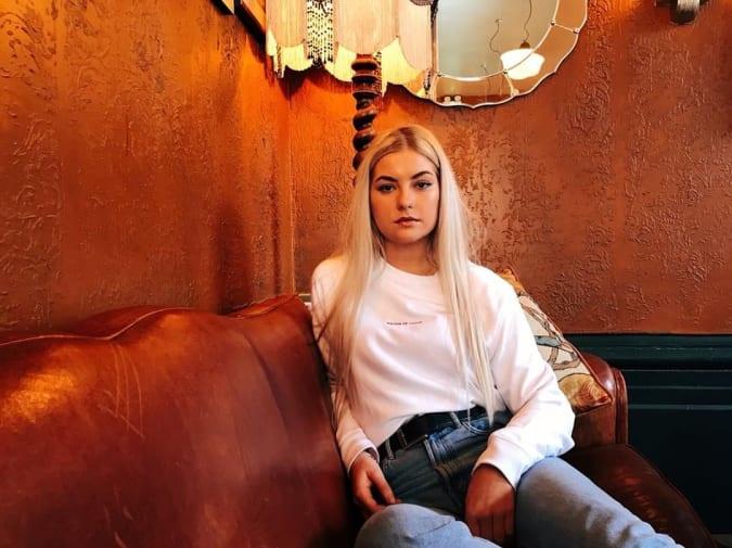 Blonde girl posing in Maison de Choup t-shirt