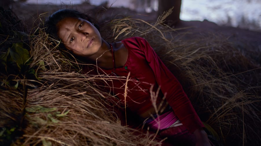 Girl laying in hay