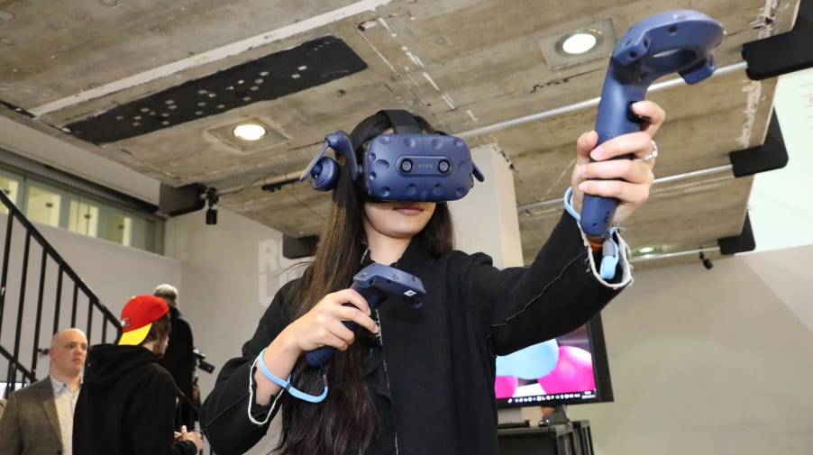 Woman wearing VR headset pointing