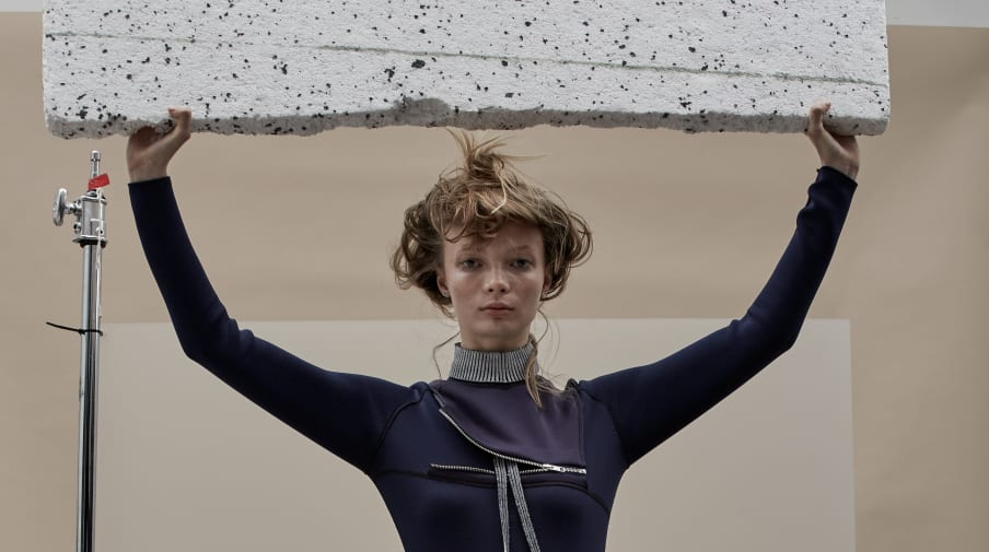 Model holding an empty sign above her head