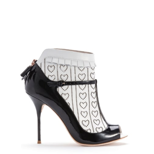 'Sadie' by Sophia Webster. Black patent t bar with white calf laser cut sock detail.