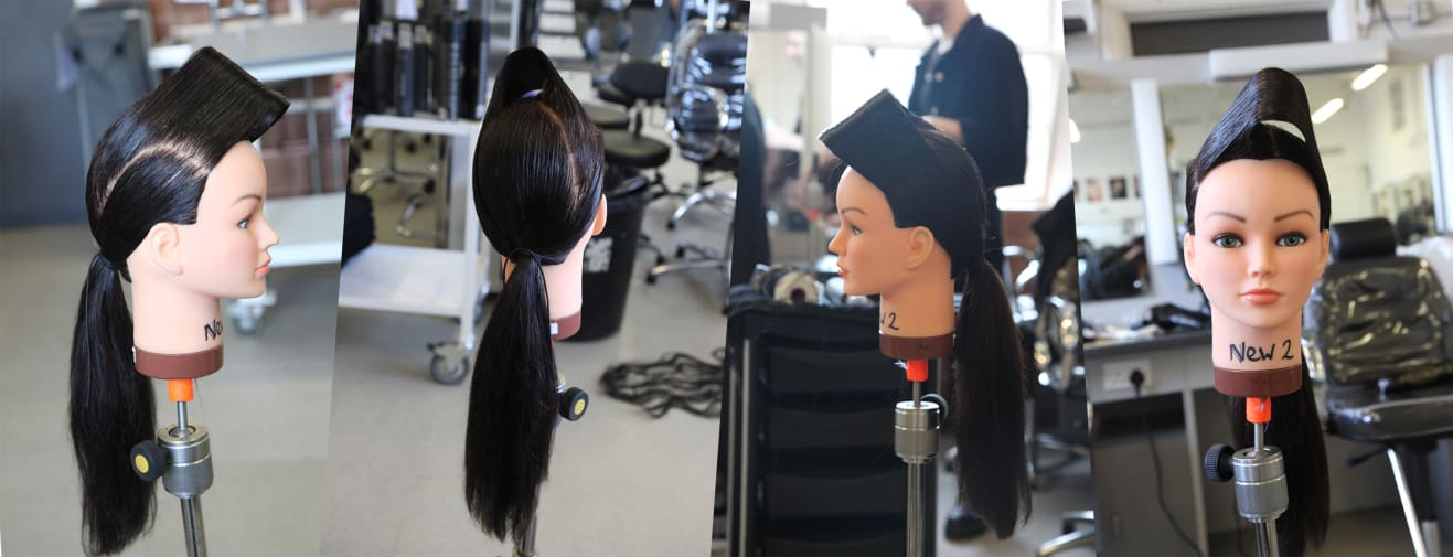 Students recreating hairstyles on model heads