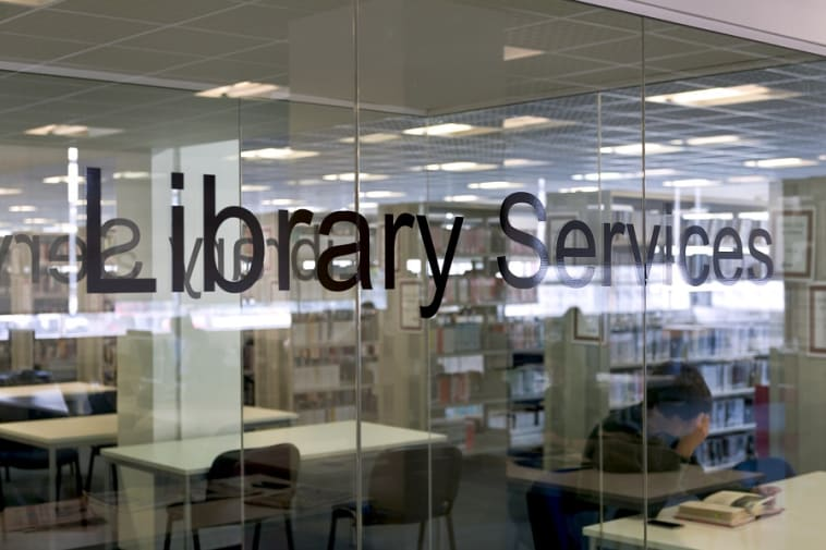 Text Library Services on some glass doors