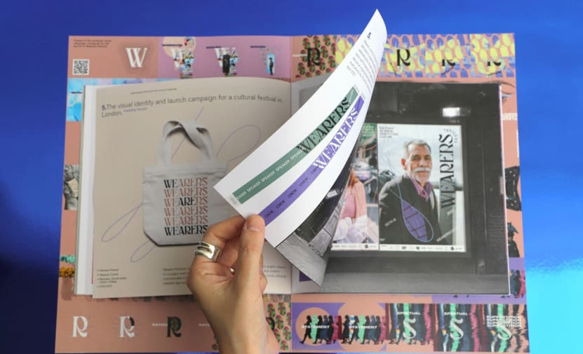 wearers festival leafing through brochure