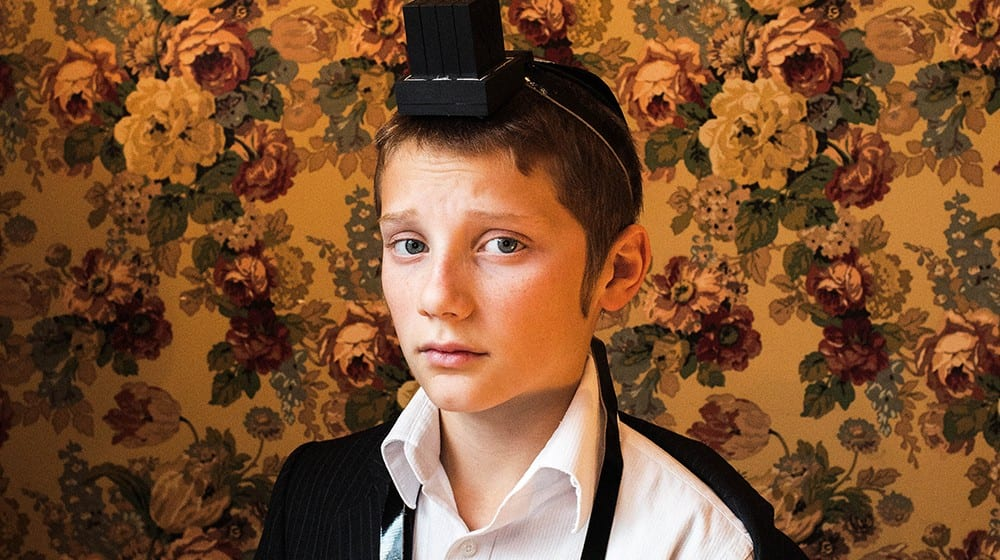 Jewish boy with wallpaper in background