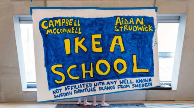 Handmade sign with 'Ikea school' written on it