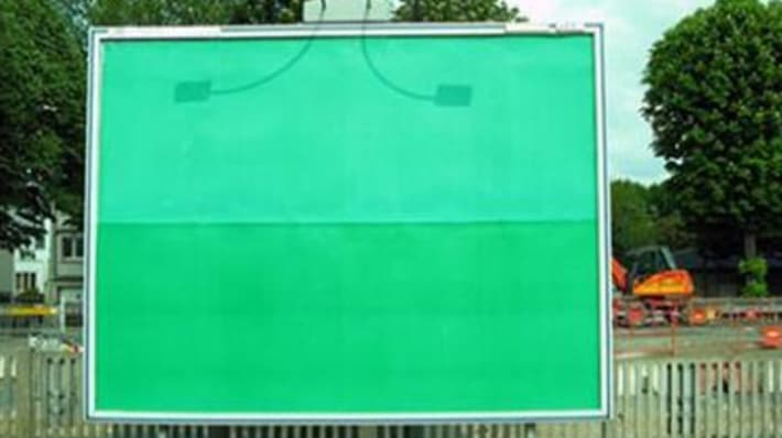 a green placeholder on a billboard