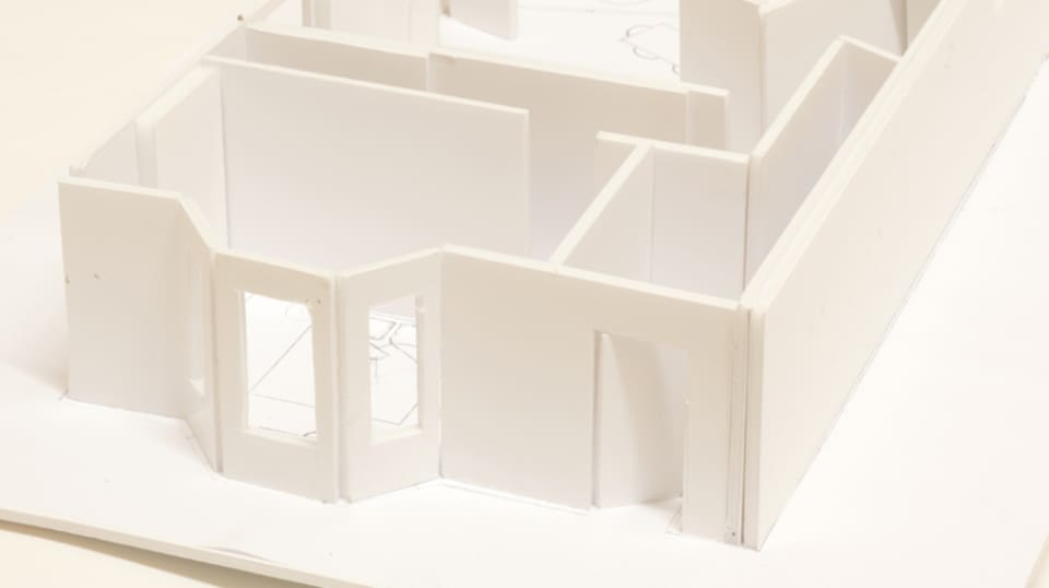3D model of a white building without a roof