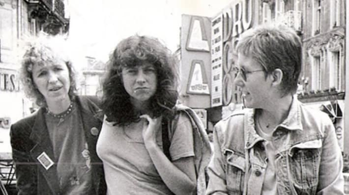 Black and white photo of Lindsay Cooper with two woman walking down a street.