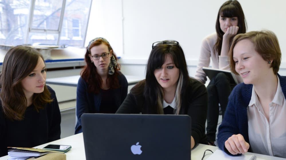 Students in front of laptop