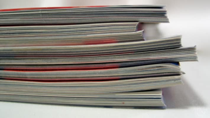 Side view of a pile of magazines