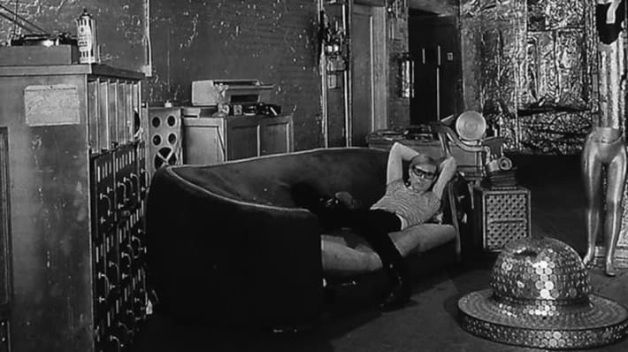 Black and white image of Andy Warhol in his studio