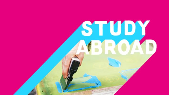 Bright pink graphic with image of a hand with a paintbrush an Study Abroad written across
