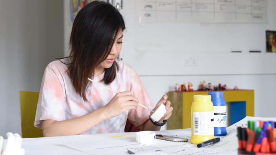 Woman using a paint brush