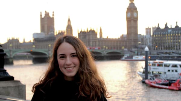 Beatriz Cardenas Garza standing by the River Thames with Big Ben in the background