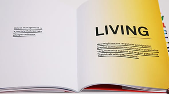 A book open to a page which says 'Living'