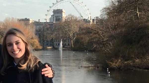 Anna Weyant standing by lake